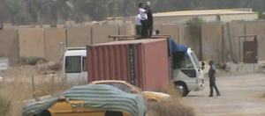 3. Agents photographing and filming Camp Liberty and throwing stones from atop police containers. 2015-09-10